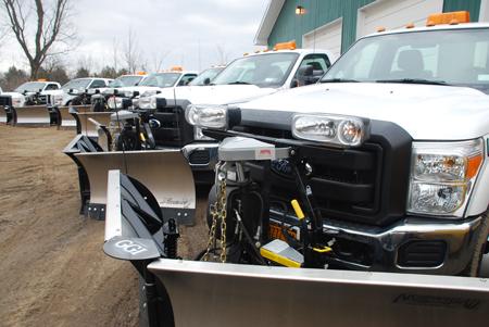 Grasshopper Garden trucks with plows