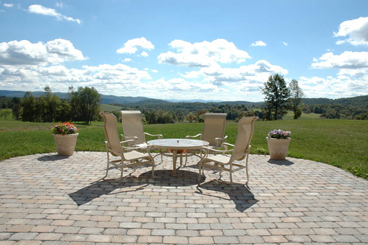 Stone patio with patio furniture and flower pots