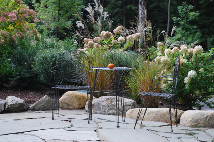 Patio with furniture, small pumpkin on table
