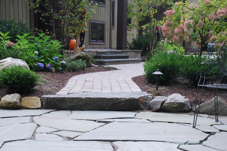 Stone walkway leading to patio