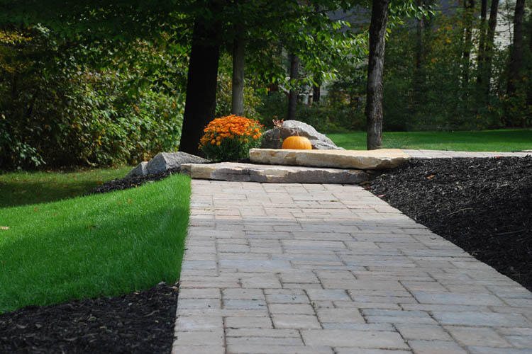Stone walkway with steps, pumpkin in background