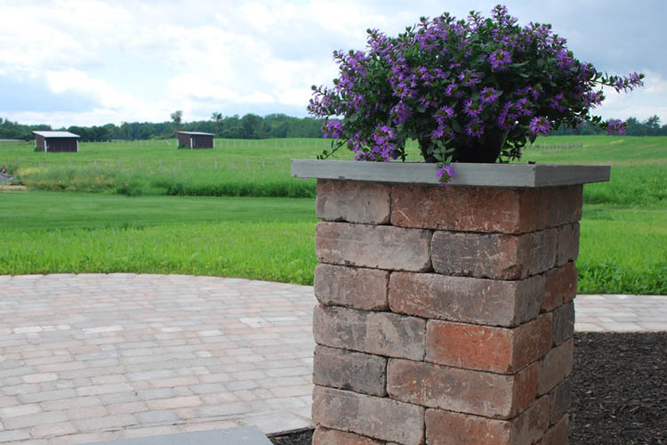 Stone pillar with flower on top