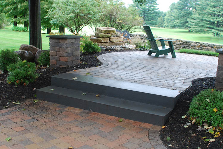 Stone patio with green Adirondack chair