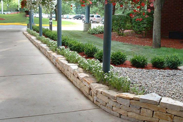Stone wall along sidewalk