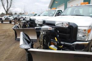 Grasshopper Garden trucks with plows attached