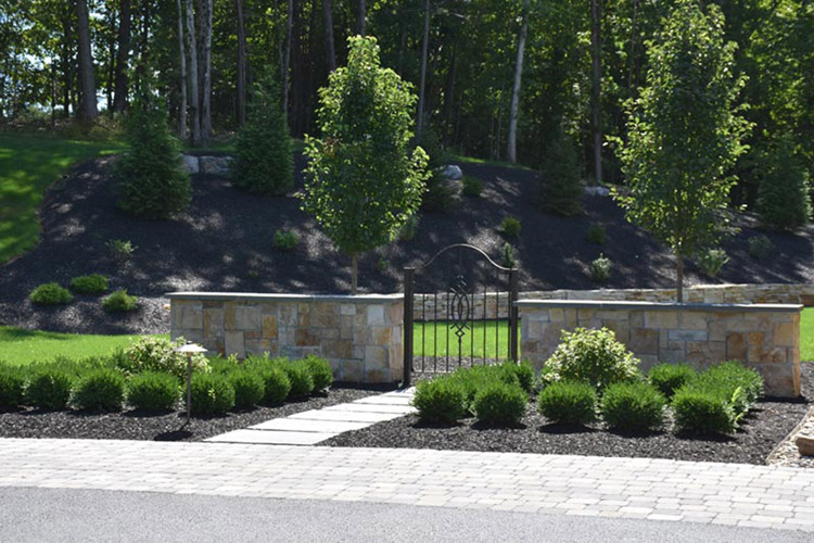 Walkway up to gated wall