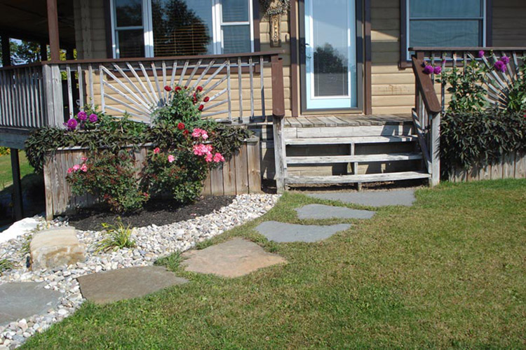 Large stone patio in grass